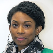 A woman in a scarf and green shirt