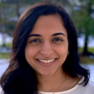 Aarti Patel in a white shirt in front of a snowy field