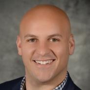 Ryan Davis in a checkered shirt and dark jacket