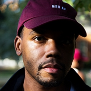 Reed in a maroon baseball cap
