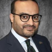 M. Najeeb Shafiq headshot in sportcoat, shirt and tie