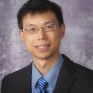 Roderick Tan headshot in suit jacket and blue shirt and tie