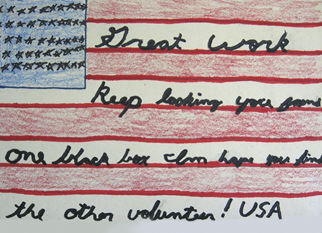 "a drawing of an American flag with text ""Great work keep looking you found one black box I'm hoping you find the over volunteer! USA"" written in the white stripes"
