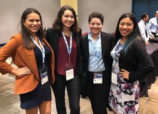 four women at a conference