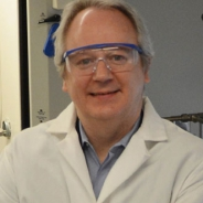 Veser in a lab coat and goggles