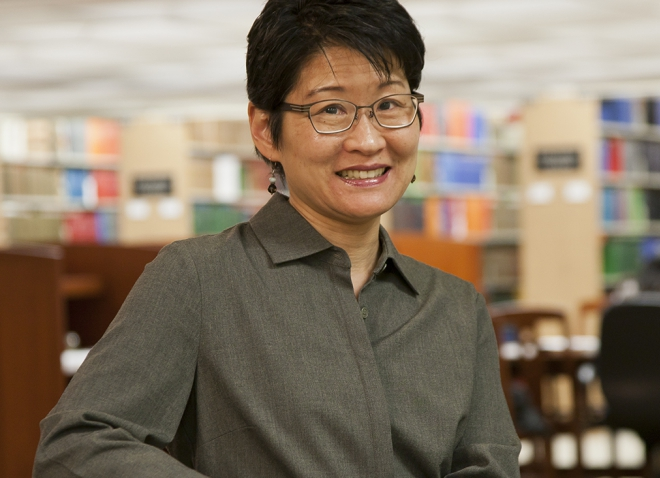 Lu-in Wang in a gray shirt in a library