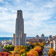 The Cathedral of Learning with colorful trees beneath