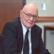 Nicholas Rescher in a black suit and tie