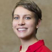 Juleen Rodakowski in a red blouse, headshot