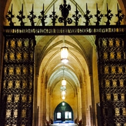 Decorative gate inside Commons Room of the Cathedral of Learning, arches of hallway in background