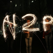 H2P spelled in sparklers in the dark