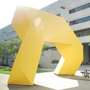 yellow statue in front of a building
