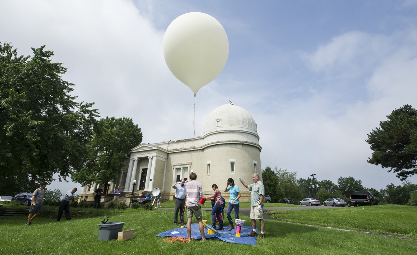 students and other researchers with test balloon at Allegheny Observatory