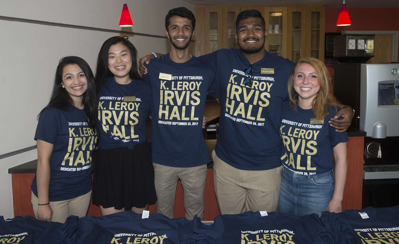 five students with K. Leroy Irvis Hall T-shirts
