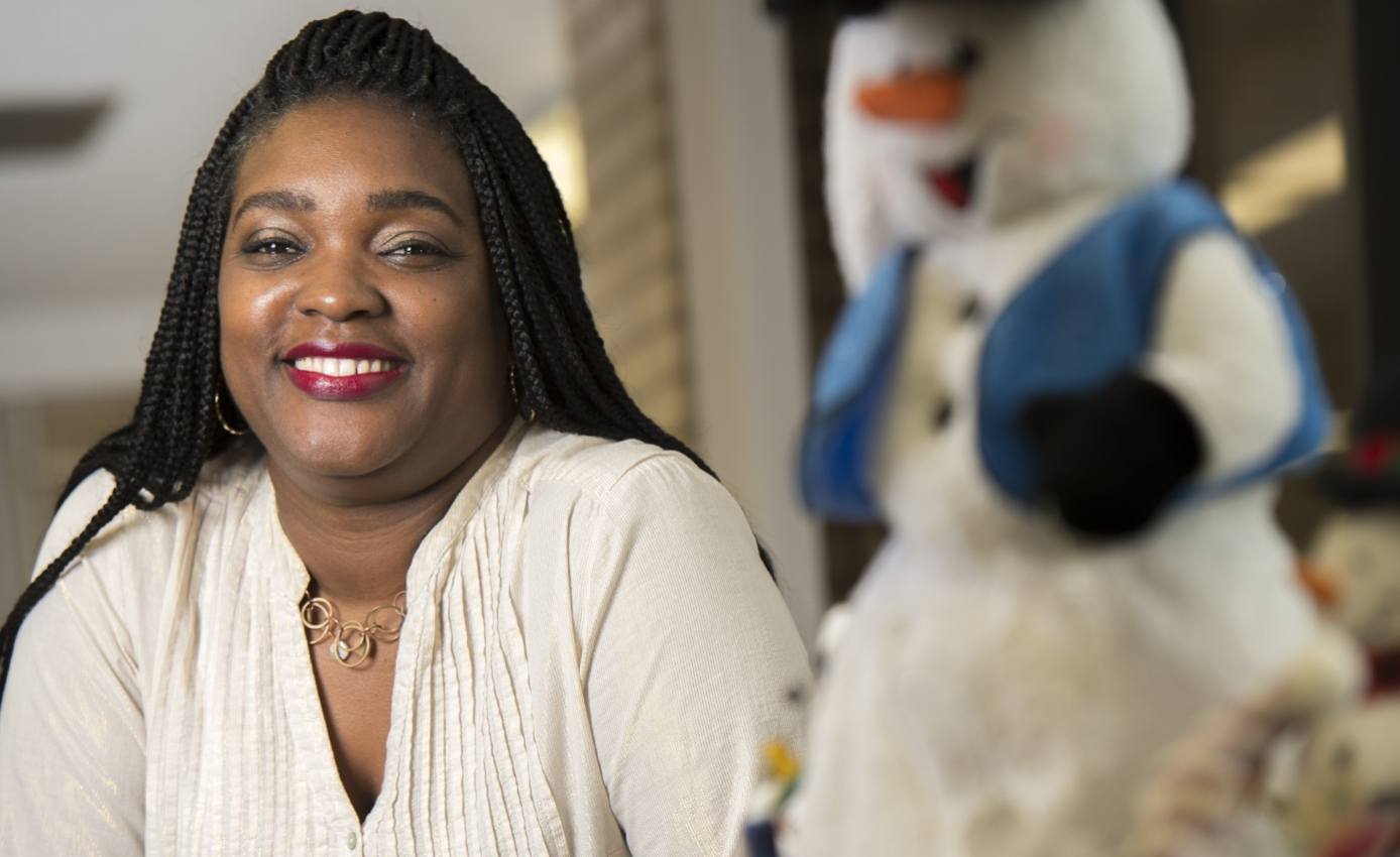 LaShawn Youngblood with snowman figuring in foreground