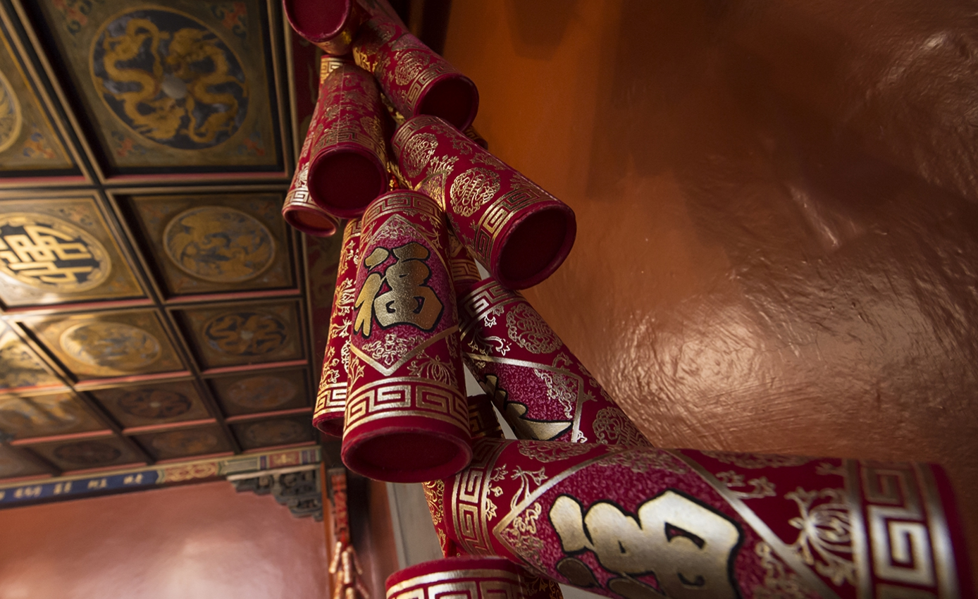 Red Chinese decorations hanging on a wall