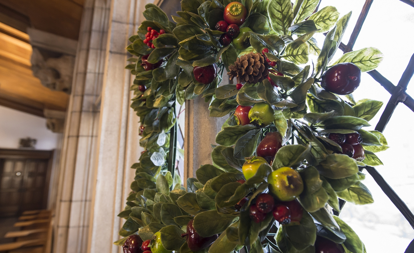 A Christmas wreath hanging on a window