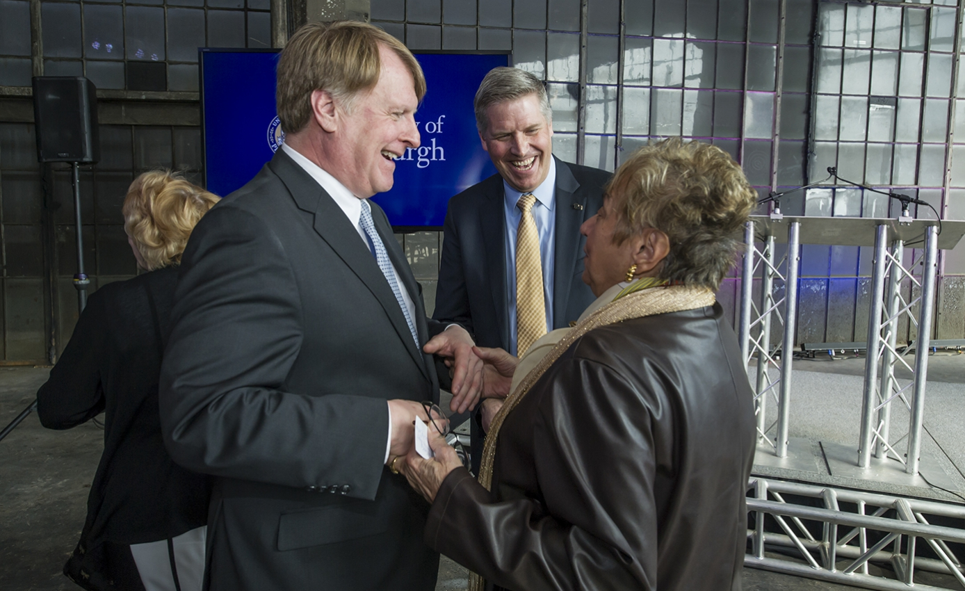 Rich Fitzgerald greeting Janet Cercone Scullion, pictured with Patrick Gallagher, at 5000 Baum announcement event
