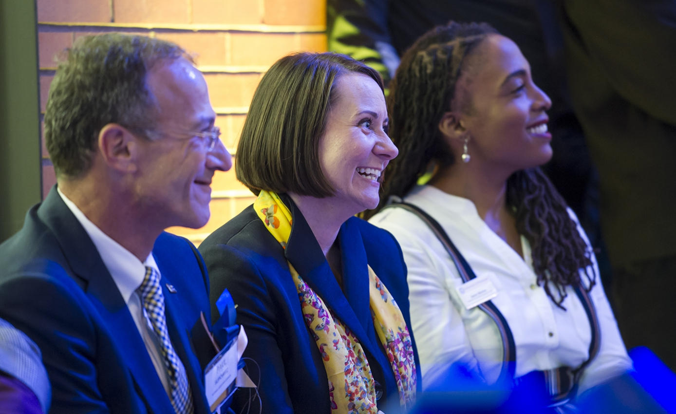 Supowitz, Dostilio and Ellerbee smiling during an event