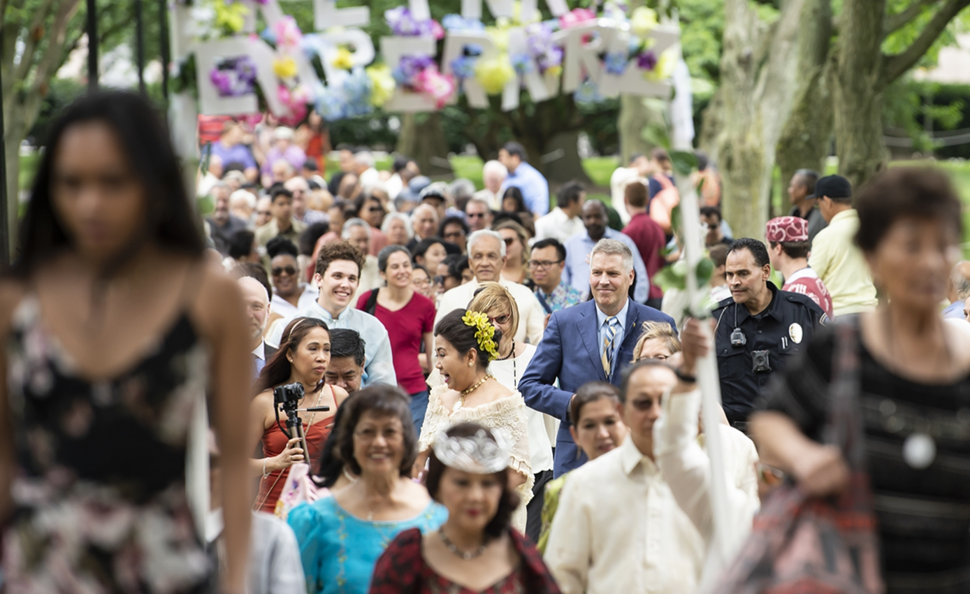 a large crowd of celebrants walking on campus