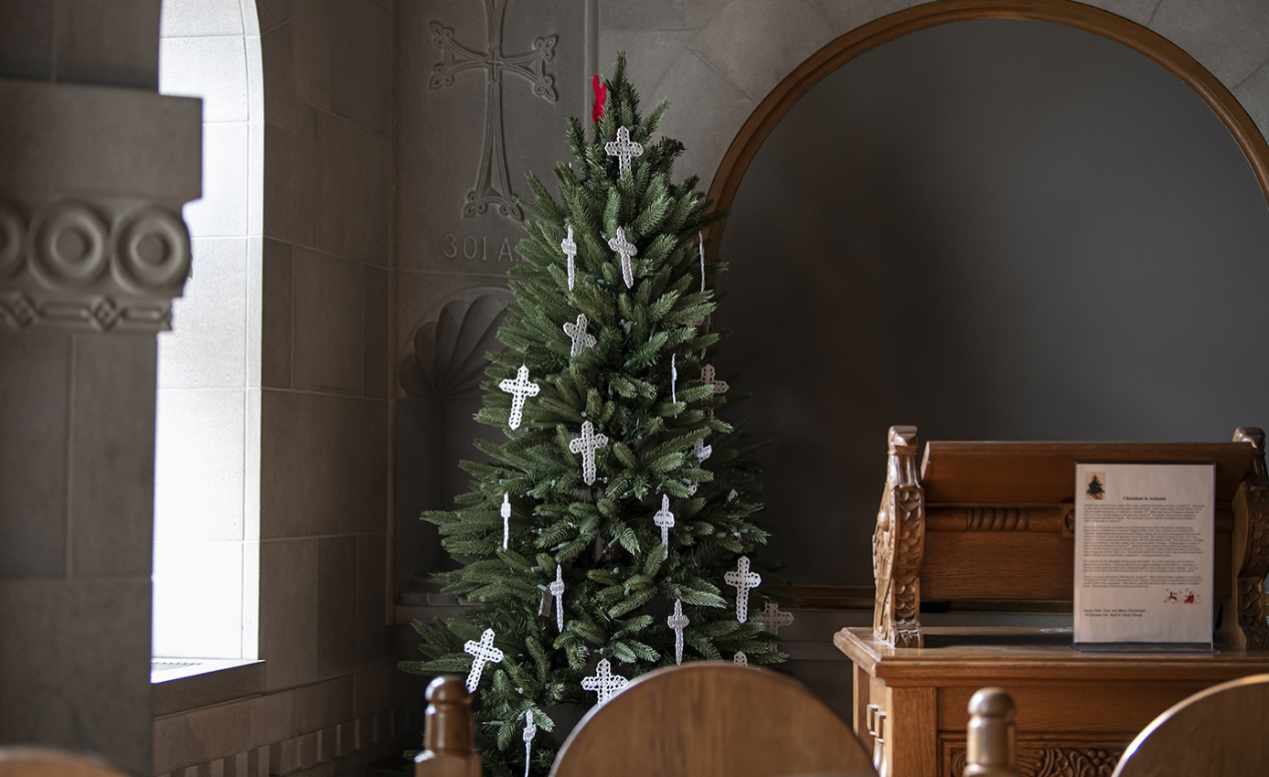 A Christmas tree with crosses in a corner