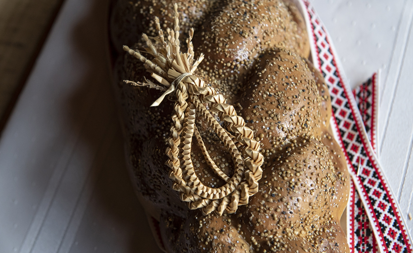 A loaf of bread beneath a brown ornament