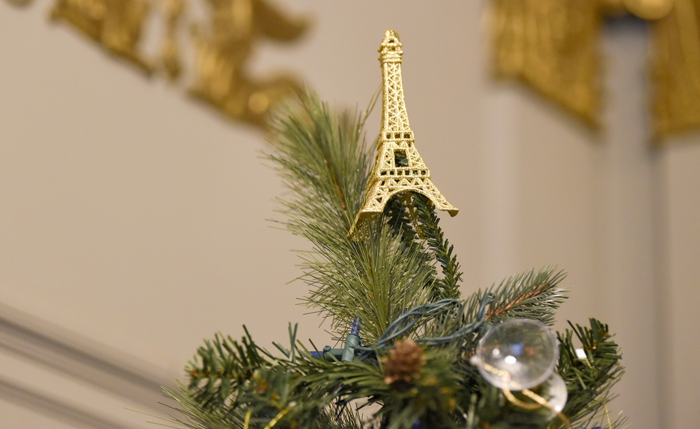 A model of the Eiffel Tower on top of a Christmas tree