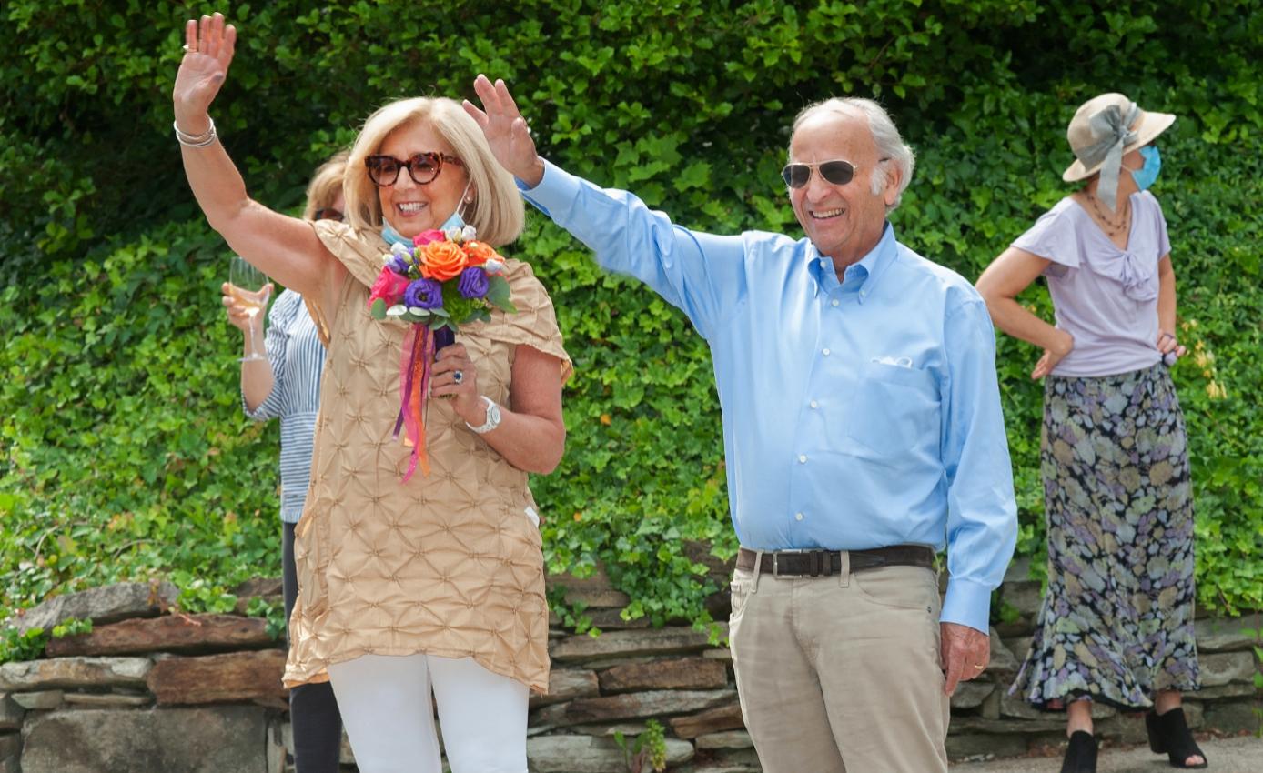 Art Levine in a light blue dress shirt and Linda Melada in a beige top