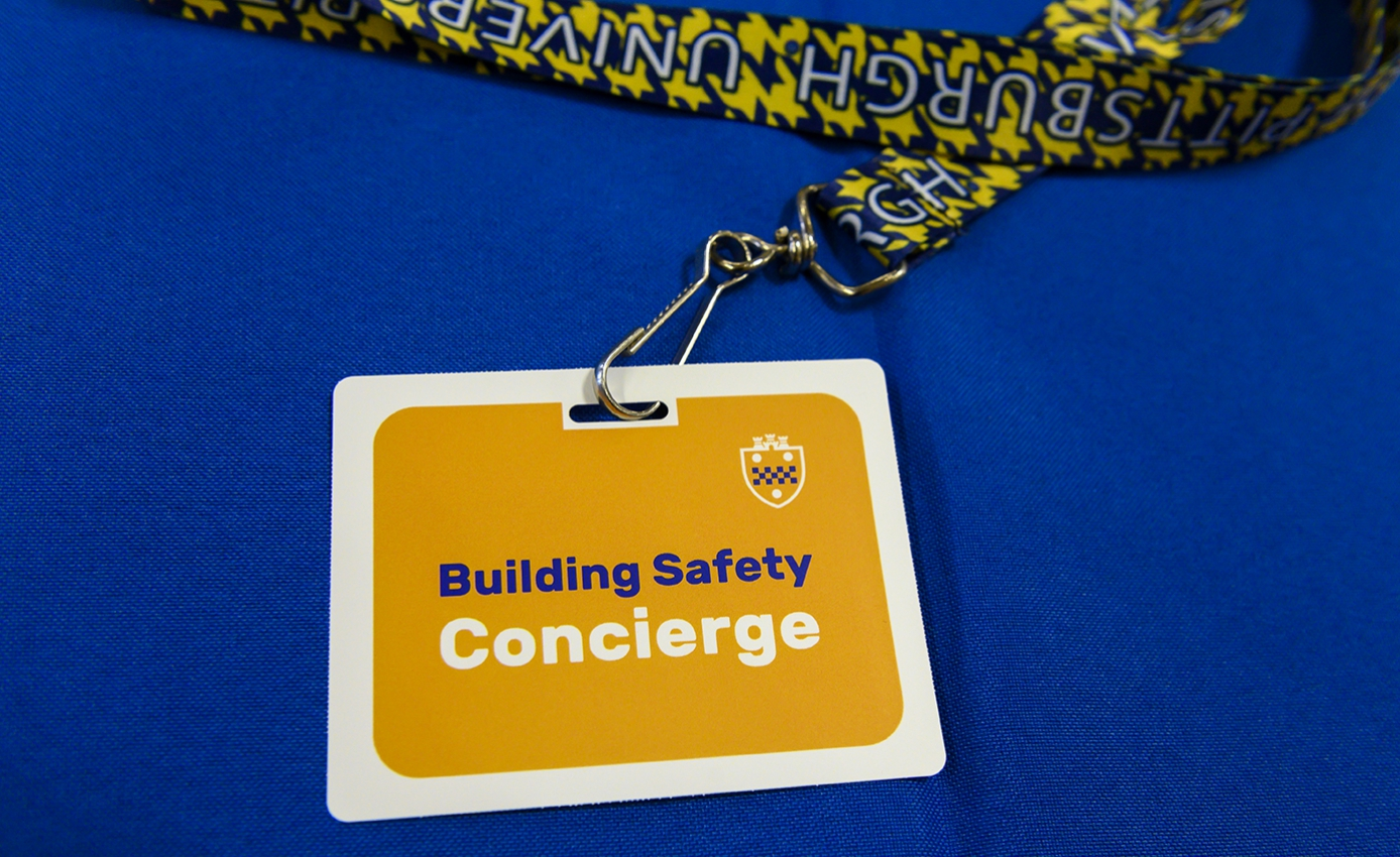 "A lanyard that reads ""Building Safety Concierge"""