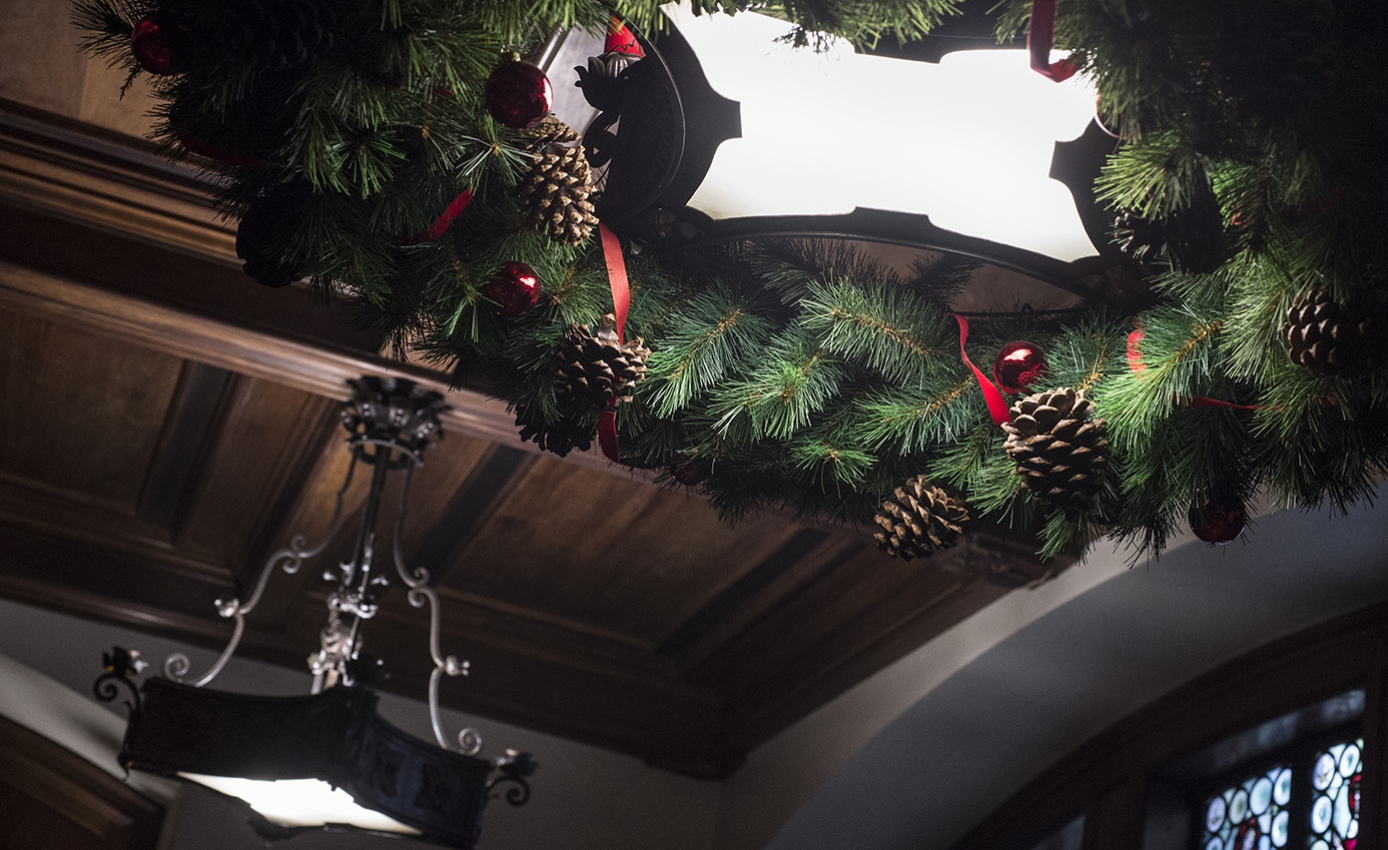 A wreath hangs around a light on the ceiling