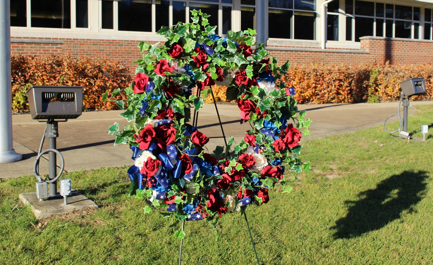 A wreath with red, white and blue flowers