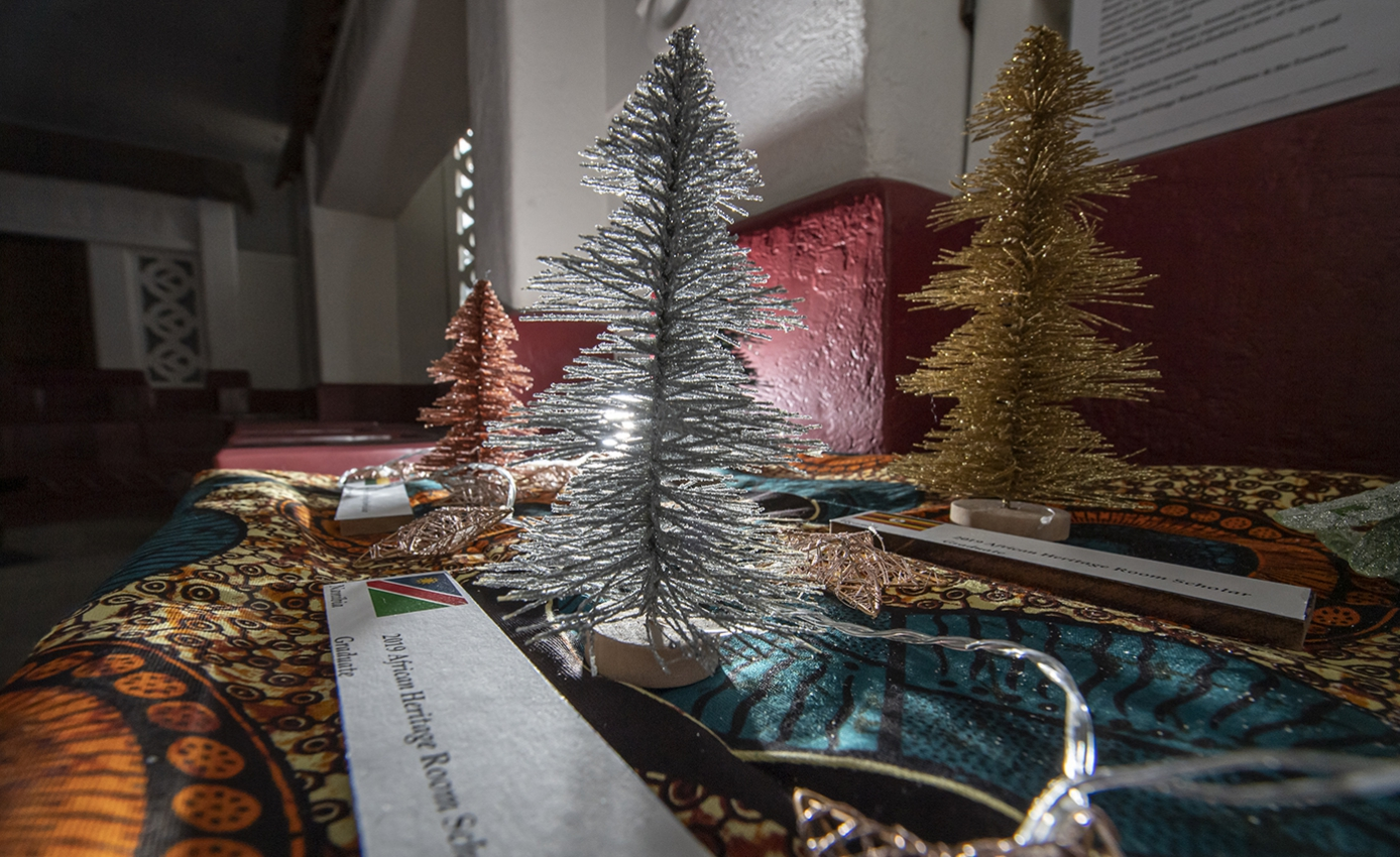 Three tinsel trees on top of a carpet
