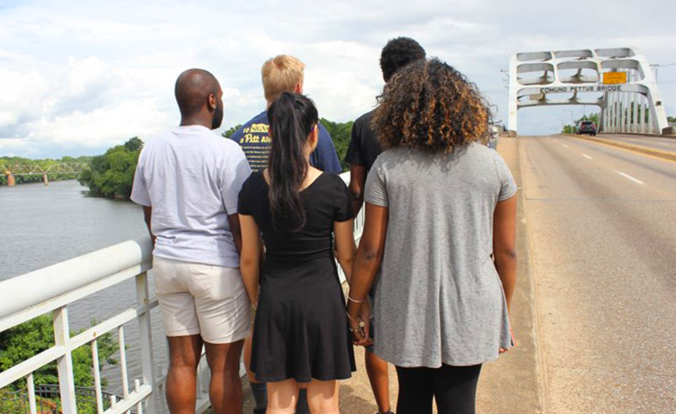 Five students looking down the Edmund Pettus Bridge