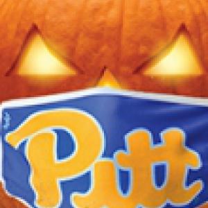 A pumpkin with a Pitt face mask on