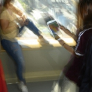Artistic photography of two women with tablets