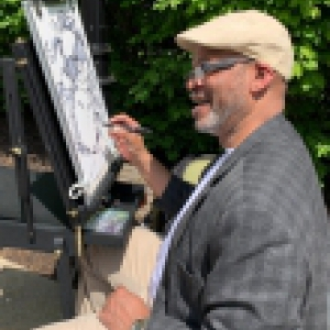 Caricature artist at 2019 picnic