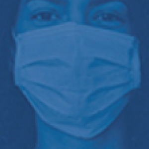 Filtered blue image of a woman in a mask