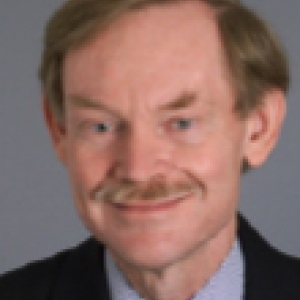 Robert B. Zoellick in a black suit and blue shirt