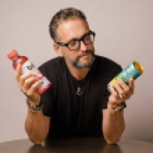 Portrait of Ben Weiss holding a can and a bottle