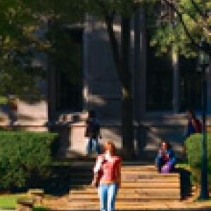 A woman walking on the sidewalk