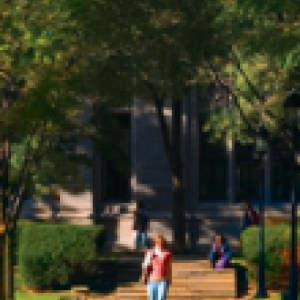 Image of a student walking down a sidewalk