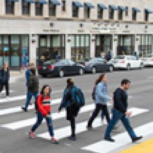 People walking across a street