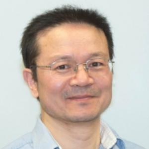 W. Vincent Liu in a light blue dress shirt