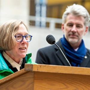 Ann E. Cudd and Greg Scott speaking outdoors