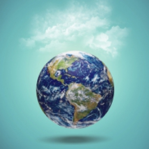 a globe on a turquoise background