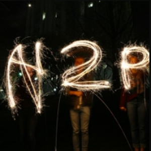 H2P spelled out in sparklers in the dark