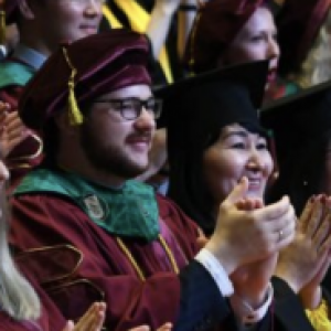 a man and a woman in graduation garb