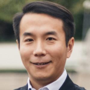 Zongqi Xia in a black suit and white dress shirt