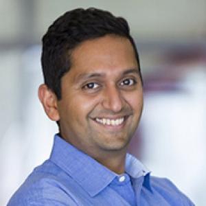 Bharath Chandrasekaran in a blue collared shirt
