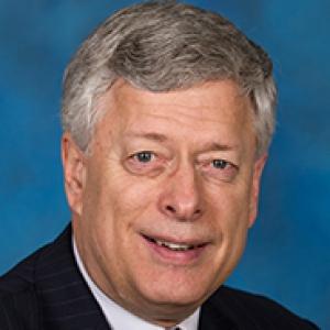 A man in a dark suit